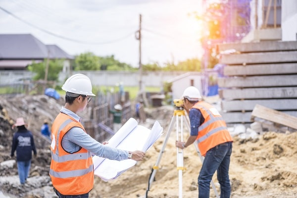 land surveyors working at new home construction